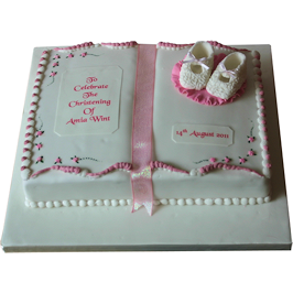 Baby boots and book christening cake